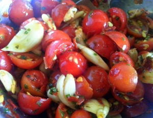 Beautiful Cherry Tomatoes with Crushed Garlic, marinated in Olive Oil and dried Basil.
